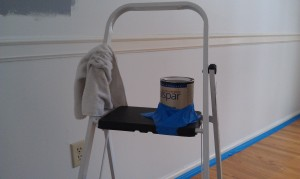 secure paint can on ladder